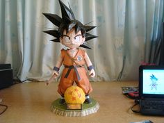 This papercraft is the Kid Goku, based on the manga / anime / game series Dragon Ball, the paper model was created by Carojama, and assembled by 3d Paper Crafts, Paper Toys, Z Craft, Origami, Dbz, Papercraft Download, Goku And Chichi, Kid Goku, Cool Dragons