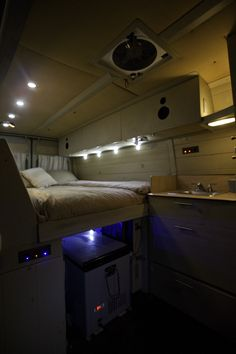 Mid Height Bed With Lighting And Lots Of Storage In Peter Kitchells Sprinter Camper Van Build