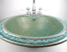 Beautiful custom handmade ceramic sink with fused glass rim in sea green by Dock 6 Pottery