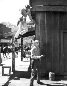 """THE RANGE RIDER (TV Syndicated Series) Jock Mahoney as """"The Range Rider"""" is leaping onto stuntman Al Wyatt - A Flying A Production by Gene Autry."""