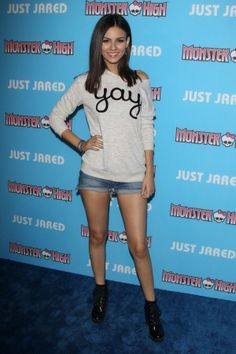 Victoria Justice wearing Aldo Serinna Boots, MINKPINK Yay Sweatshirt and Joe's Jeans Cut Off Shorts