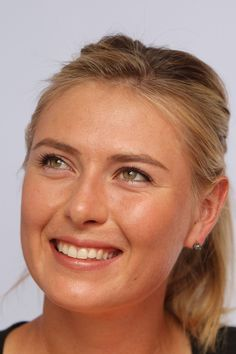 Maria Sharapova Photos Photos - Maria Sharapova of Russia smiles at the Tennis…