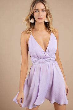 Feel romantic in our Juliet Plunging Skater Dress. Featuring a plunging neckline, open criss cross back, and full flowing skirt. Pair with wedges to d Lavender Dresses, Lilac Dress, Short Lavender Dress, Best Prom Dresses, Homecoming Dresses, Dress Outfits, Casual Dresses, Purple Dress Casual, Dress Black