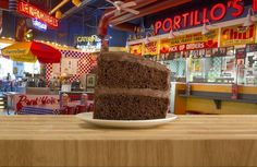 CHICAGO — Portillo's is having a birthday and it wants you to help celebrate with cake. For their anniversary, you can get a slice of their chocolate cake for 55 cents. Original Pancake House, The Pancake House, Famous Chocolate, Chocolate Cake, Onion Loaf, Salads Up, Crab House, Beef Hot Dogs, Cakes Today