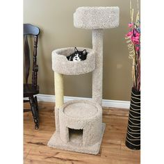 "Our 52"" Cat Tree has been designed with your cats comfort in mind! This multi-level cat tower features a cozy round room on the first level, with a large opening that's perfect for hiding and your kitty can also use the roof as a place to lounge. The second and third levels boast super plush and cozy kitty beds that also have deep set edges for added security while your beloved felines sleep! Off to the side is an elongated sisal rope scratching post, which helps promote healthy nail..."