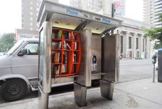 Trading one antiquated form of communication for another... Architect John Locke converted old phone booths in NYC into pop-up libraries.