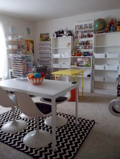 Great craft room with lots of storage and work space. Click through to the blog for more photos of this room!