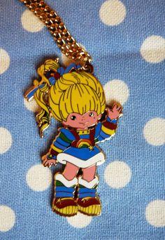 Fab 80s cartoon Rainbow Brite pendant on 70cm gold coloured chain.    This is a vintage charm in excellent condition which I have added a new chain