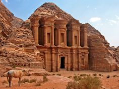 """The rock-cut architecture of Petra, Jordan, stretches back to the 6th century B.C., yet it remained unknown to the Western world until 1812. Since then, the """"rose-red city half as old as time,"""" as an 1845 poem described it, has become an enviable tourist destination -- described by Smithsonian Magazine as one of the top places to see before you die. Among Petra's sites is the Al Deir monastery, pictured here."""