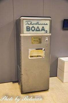 Soda vending machine, circa 70s «Советский дизайн 1950–1980-х годов». 1-2Glasses were provided in the slot. You could rinse them by placing them upside down over the water fountain and pushing down  the glass to release water. 1 kopek for sparkling , 3 kopeks for sparkling with syrup