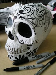 Day of the dead decorations, from a thrift store skull.