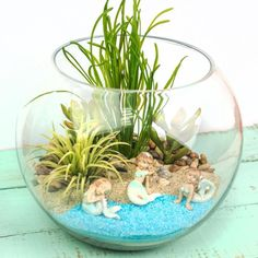Decorate your home with a creative take on fairy gardens — miniature mermaid gardens. #miniaturegardens #miniaturefairygardens