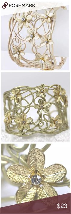 "D14 Gold Metal Flower & Crystal Cuff Bracelet ‼️ PRICE FIRM UNLESS BUNDLED WITH OTHER ITEMS FROM MY CLOSET ‼️   Fabulous bracelet!  Gold color metal with rhinestone center textured flowers. 2.3"" wide.  Please check my closet for many more items including designer clothing, shoes, handbags, scarves and much more! Handmade Jewelry Bracelets"