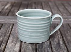 Handmade porcelain mug in a glossy blue grey glaze, thrown on a potter's wheel. Dimensions: Diameter: Height: Porcelain with a glossy glaze. Handmade in England. Porcelain Mugs, Blue Grey, Glaze, Pots, Tableware, Handmade, Enamel, Dinnerware, Hand Made