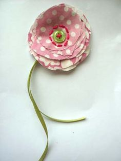 broche made of recycled shirt, ribbon and button