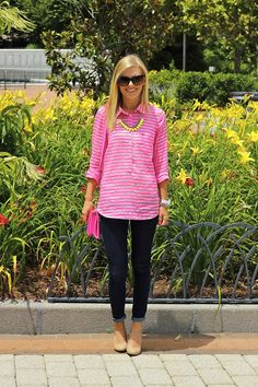 Pink stripe tunic shirt, dark wash skinny jeans, nude pumps, neon pink cross body, and a neon yellow statement necklace.
