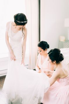 A little help from her bridesmaids! http://www.stylemepretty.com/vault/gallery/39621 | Photography: Emily Delamater - http://emilydelamaterphotography.com/