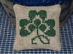 Cross stitch Shamrock mini pillow or pin keep for St Patrick's Day.