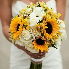 Sunflowers are some of the best flowers for a fall wedding. They symbolize long life, adoration, loyalty, positivity, strength, good luck, and lasting happiness.