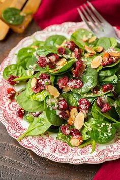 It's that time of year where most of us could probably use a few more greens in our diet between all those cookies :). Here is a simple Cranberry Spinach Salad with a Sesame Seed Dressing that would be perfect to serve on Christmas. It's got the perfect blend of sweet + savory + toasted crunchy goodness and you'll