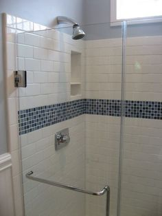 white subway tile with glass tile decorative band for master shower