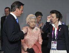 The Queen is greeted by Princess Anne (right) and David Cameron after her spectacular entrance into the Olympic Stadium