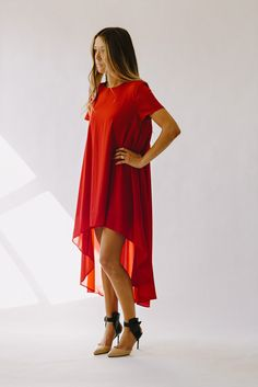 Our favorite dress! Loose fitting with a flowy train our draped red dress is perfect for any party or wedding you have coming up. Also available in Black.