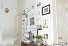 Love the white frame wall - link also includes a Book Page Wall Art tutorial