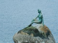 Girl in a Wetsuit is a life size bronze sculpture by Elek Imredy of a woman in a wetsuit, located on a rock in the water along the north side of Stanley Park, Vancouver, British Columbia, Canada.