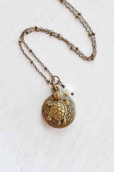 Turtle Locket NecklaceSea Turtle Locket JewelryBaby by KimFong Locket Charms, Locket Necklace, Pendant Necklace, Necklaces, Sea Turtle Jewelry, Ocean Turtle, Baby Tortoise, Antler Necklace, Pocket Watch Necklace