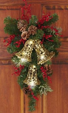 Holiday Bells Evergreen Swag Door Decor - Vertical evergreen floral swag features white lights that dazzle Link Christmas Door Decorations, Christmas Swags, Christmas Arrangements, Christmas Bells, Holiday Wreaths, Christmas Holidays, Christmas Ornaments, Burlap Christmas, Christmas Projects