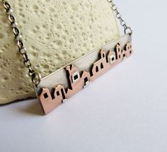 Houses necklace Sterling silver and copper metalwork by Mirma, $144.00