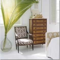 Large palm frond in a large glass holder being used for a bit of shade! Creative, beautiful and useful.