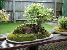 Hobbit hole replica with a living bonsai tree.  This pin gives a tutorial of how the original was created.  Very Cool!