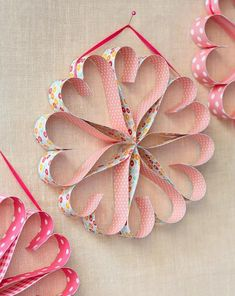 How to make an easy paper heart wreath for Valentine's Day: http://www.midwestliving.com/homes/seasonal-decorating/easy-valentines-day-decorations-and-gifts/?page=24