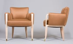 A pair of elegant French 40's armchairs by Paul Frechet  Ash veneer with bronze sabots. Model designed for the Élysée Palace in Paris.  France, c. 1946