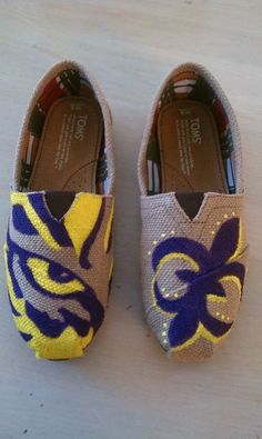 LSU Toms by PaigeKirbo on Etsy, $95.00  Kinda pricey for my taste, but love them and would totally accept them as a gift! LOL