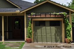 Vine in pots on garage trellis.  Drive-By Gardens: Lawn-gone curb appeal in Crestview, Brentwood and Allandale | Digging