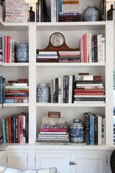 Perfect #bookshelf #styling ...Love the blue and white pottery used a book ends.