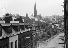 Radcliffe, Stand Lane, view from Co op looking S 1970s Shops on left, Barclay's bank at the end of the row. Radcliffe Public Library and in the background St John's church spire.