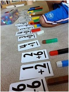 I love this because, by following directions, the Lego stack gives you the answer. Kindergarten math for a kiddo who likes Legos