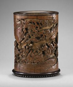 Rare pot à pinceaux en bambou sculpté Dynastie Qing, époque Kangxi  A RARE WELL-CARVED BAMBOO BRUSHPOT CARVED WITH THE EIGHT IMMORTALS IN A RAFT, QING DYNASTY, KANGXI PERIOD
