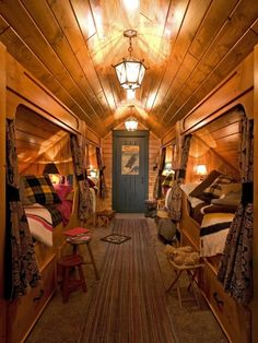 Something like this for bunkroom at camp; not quite so dark though--will have windows; but like the individual sleep compartments and storage drawers.