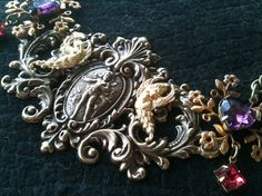 A little mix of Art Nouveau and Victorian, but when I was younger I would have worn it. Metal Collage / Assemblage Necklace  Baroque by decadentdelusion, $80.00