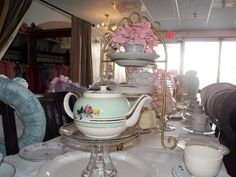 Put a teapot on a cake stand and tea bags under?