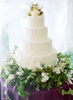4-tier white wedding cake with sprawling greenery Photography: Austin Gros - austingros.com Read More: http://www.stylemepretty.com/2014/05/27/wisconsin-nature-reserve-wedding/