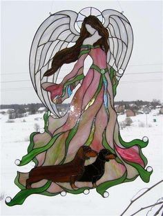 Stained glass angel, what's with the Dachshunds?