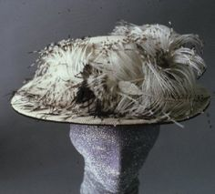 Circa 1910 white silk hat with high crown and white ostrich feathers tipped with black at crown.