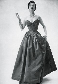 Barbara Goalen is wearing a Horrockses evening dress as seen in Vogue, 1952 flickr.com