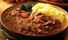 Mince and Tatties - no more standard, traditional, Scottish meal could you find.  It's not big, it's not clever, but as I child I would lick the plate clean.  Ground beef (mince) and mashed potatoes (tatties), for those not familiar with the lingo.
